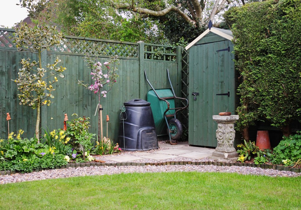 Garden compost container. Attractive storage shed and landscaped yard. #HowToMakeOrganicCompost #MakingOrganicCompost #StorageShed #GardensAll #MakeCompost #GardensAll