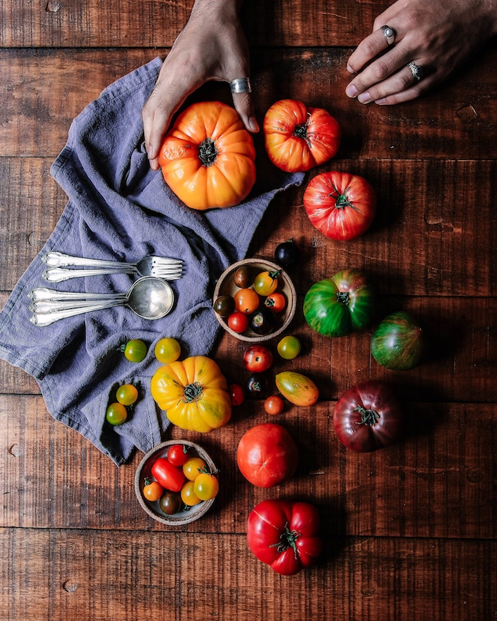 Colored tomatoes add visual interest to the garden, landscape and the plate! #ColoredTomatoes #OrangeTomatoes #YellowTomatoes #PurpleTomatoes #GreenTomatoes #BlackTomatoes