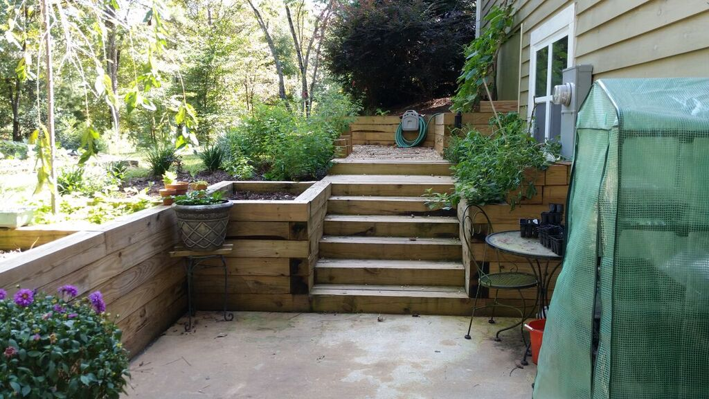 Container gardens - garden planters next to steps.