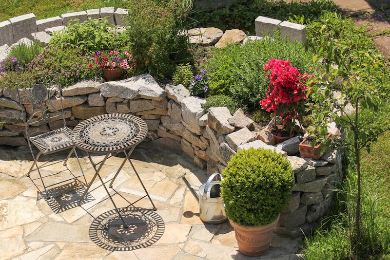 Beautiful landscape stone raised garden garden. #StoneGardenWall #StoneRaisedGarden #StoneLandscape