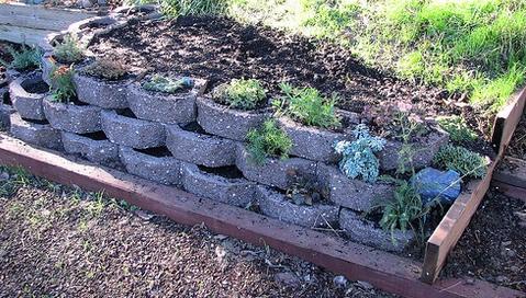 Interlocking concrete blocks create sturdy raised garden beds. #ConcreteRaisedGardenBeds #RaisedGardenBeds #LandscapeBlocks