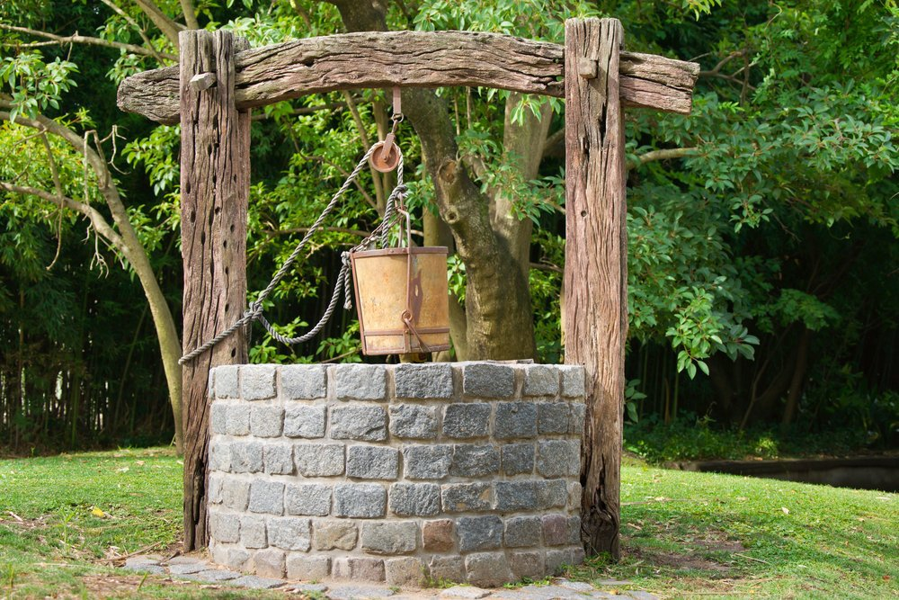 Attractive country well, stone and timber well - decorative well